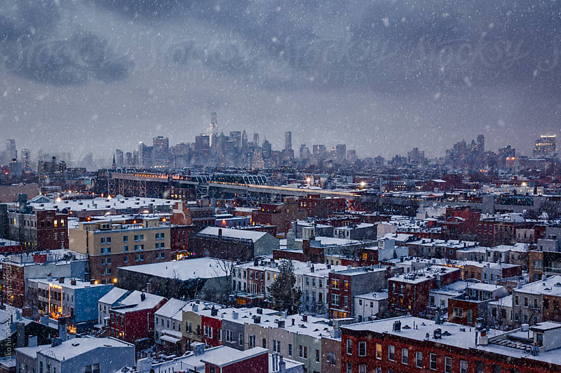 Snowy New York - Lower Manhattan skyline over Brooklyn apartment rooftops by yuko hirao for Stocksy United