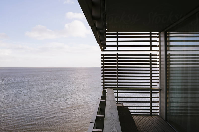 Modern balcony at the shore by Urs Siedentop & Co for Stocksy United