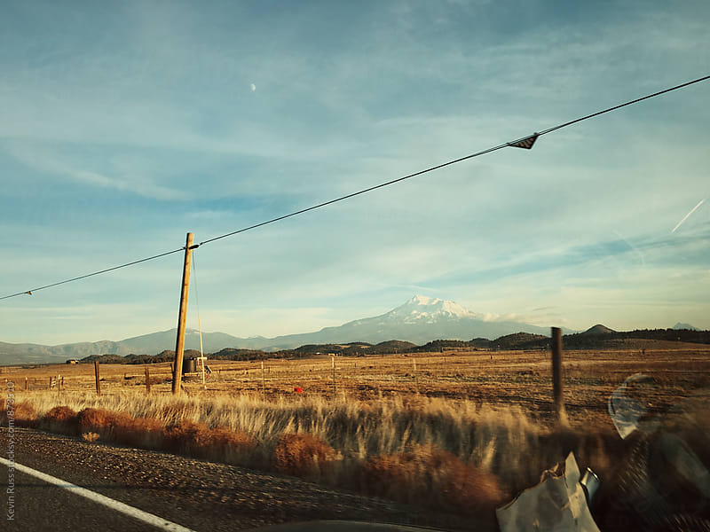 Mount Shasta View Out Car Window by Kevin Russ for Stocksy United