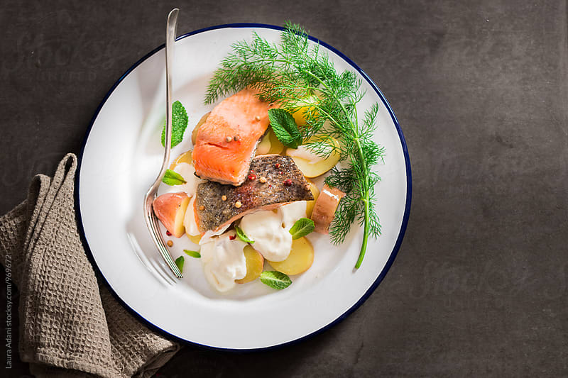 Sauteed fillet trout with potato salad by Laura Adani for Stocksy United