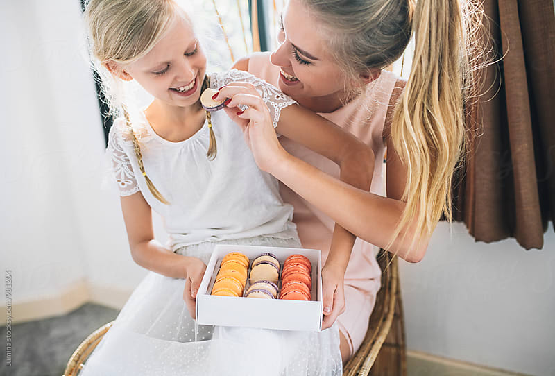 Mother and Daughter Eating Macarons