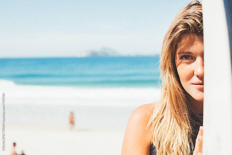 Headshot of Blond Female Surfer Girl Holding Surfboard by VISUALSPECTRUM for Stocksy United