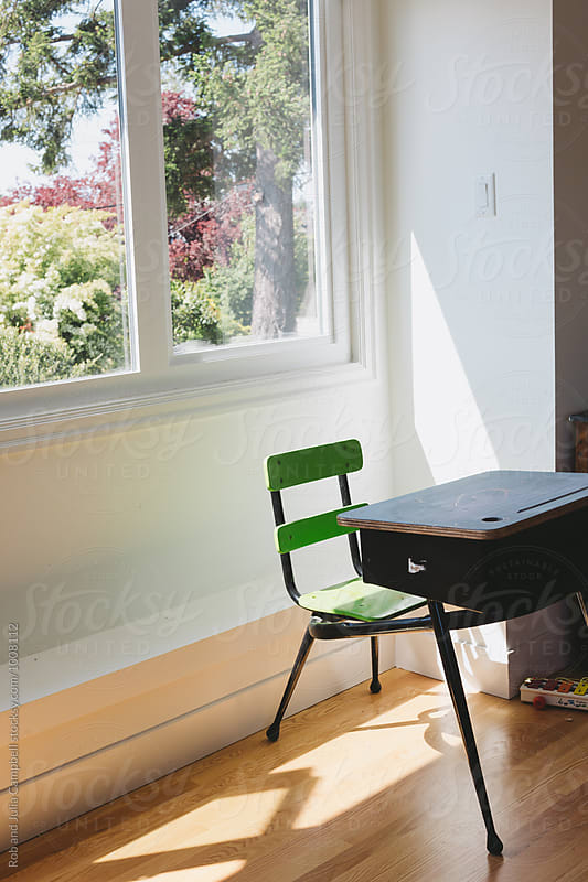 Desk chair near window by Rob and Julia Campbell for Stocksy United