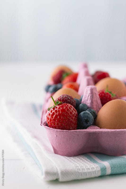 Eggs and Summer Berries vertical by Kirsty Begg for Stocksy United