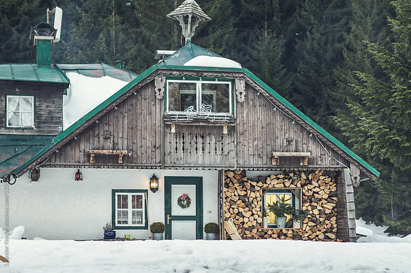 rustic old house in snow landscape by Leander Nardin for Stocksy United