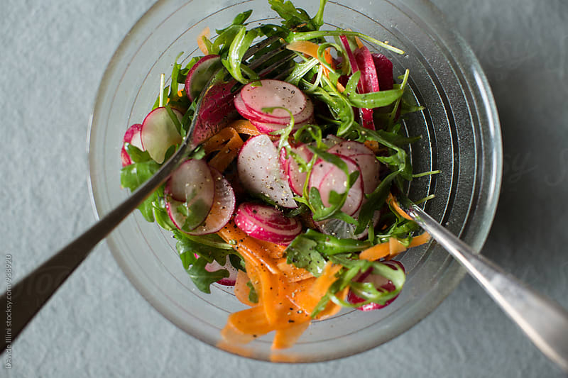 Mixed salad with radishes and carrots by Davide Illini for Stocksy United