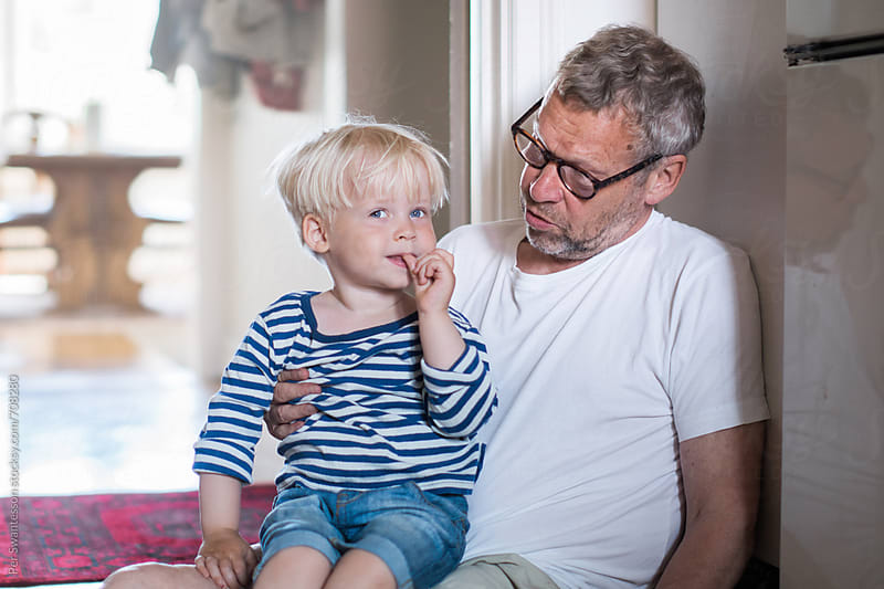 Grandfather and grandson enjoying being together by Per Swantesson for Stocksy United