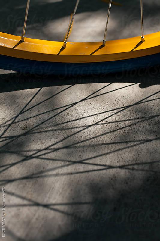 Bike tire and shadow. by Robert Zaleski for Stocksy United