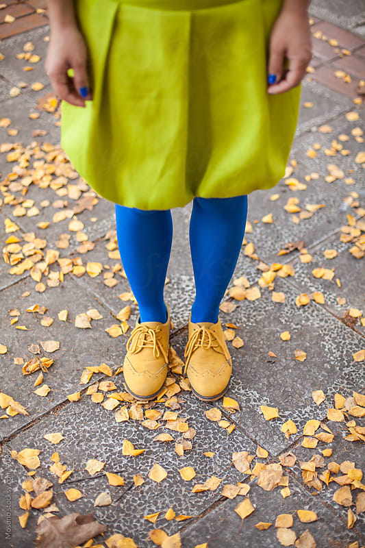 Woman in a Green Skirt and Blue Tights by Mosuno for Stocksy United