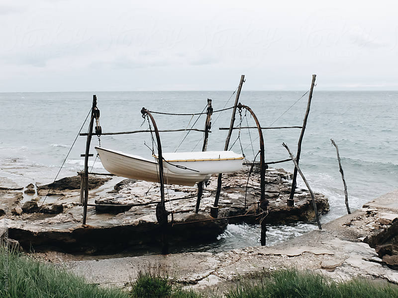 The boats hanging over the sea by Anna Malgina for Stocksy United