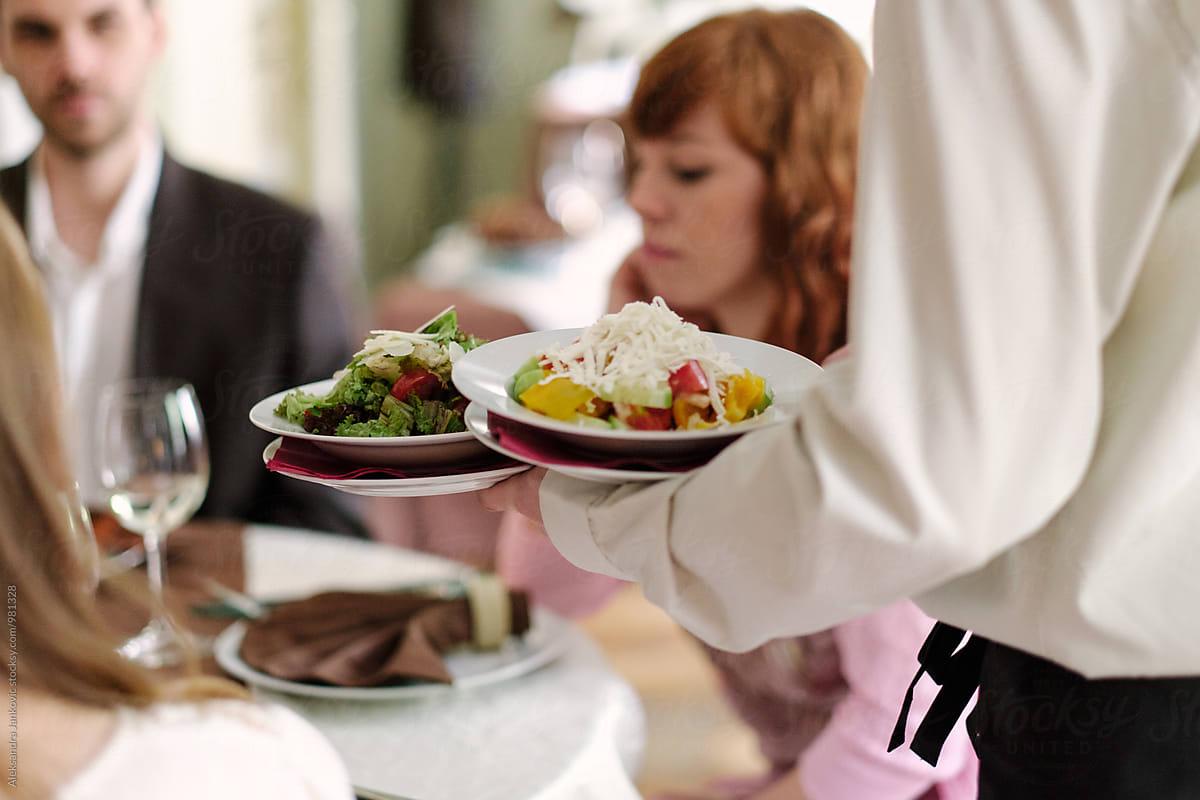 Waiter Serving Food At The Restaurant by Aleksandra Jankovic - Restaurant, Waiter