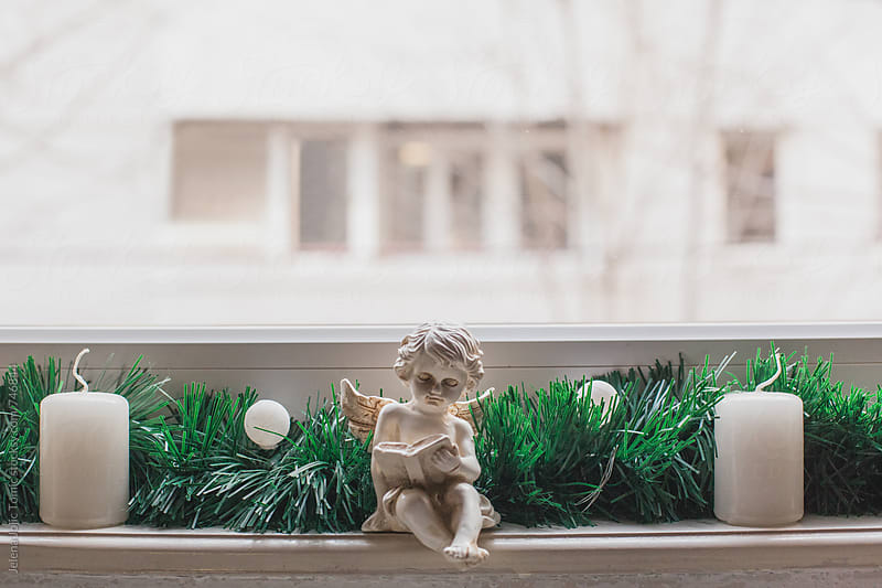 Christmas decorations at the window by Jelena Jojic Tomic for Stocksy United