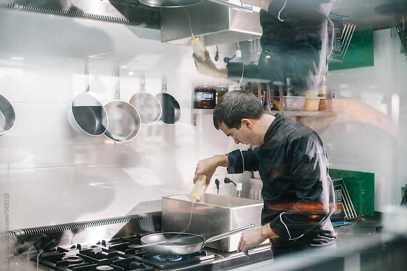 Chef Preparing Food in a Kitchen by Lumina for Stocksy United