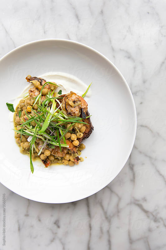 Chickpeas on toast with garnish by Sophia Hsin for Stocksy United