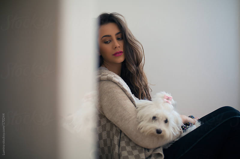 Girl and Her Dog by Lumina for Stocksy United