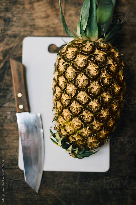 Pineapple on White Cutting Board by Marija Savic for Stocksy United