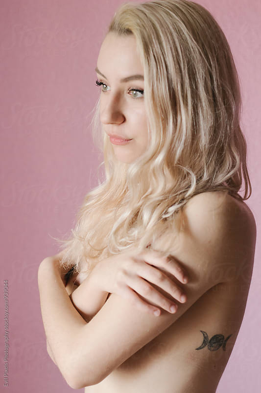Portrait of a beautiful young blonde female model by Evil Pixels Photography for Stocksy United