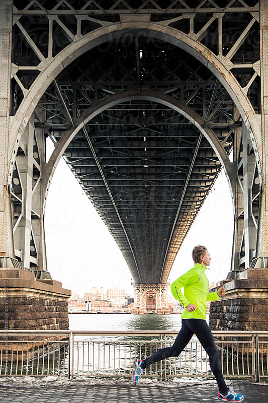 Male runner running under Manhattan Bridge by Ann-Sophie Fjelloe-Jensen for Stocksy United