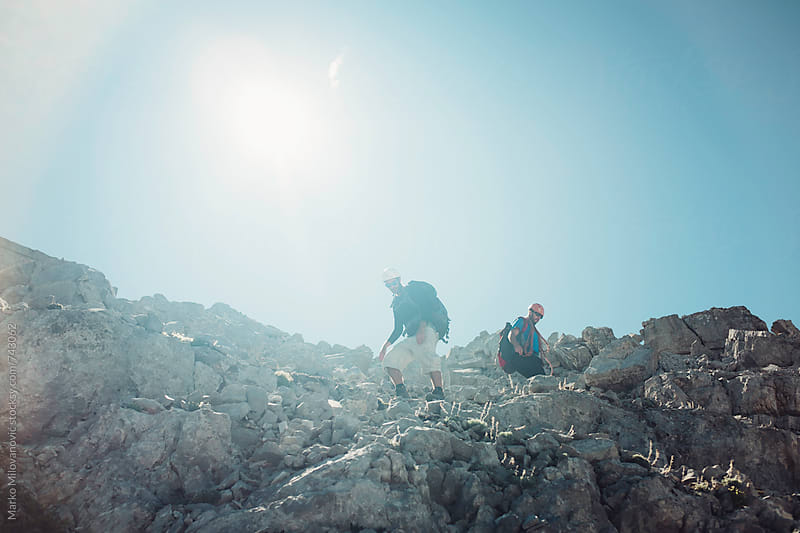 Two male mountaineers at rocky high mountain by Marko Milovanović for Stocksy United