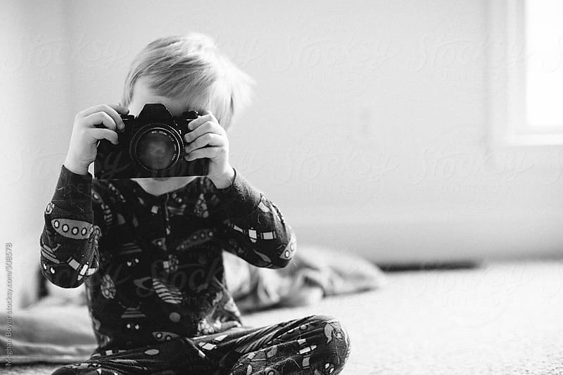little boy pretending to take a photo by Meghan Boyer for Stocksy United