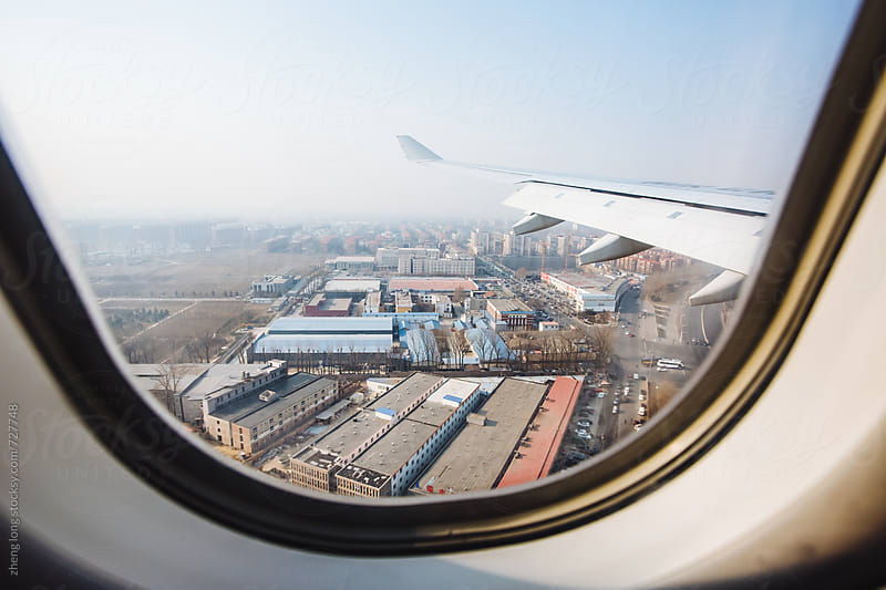 The plane is about to arrive in Beijing by zheng long for Stocksy United