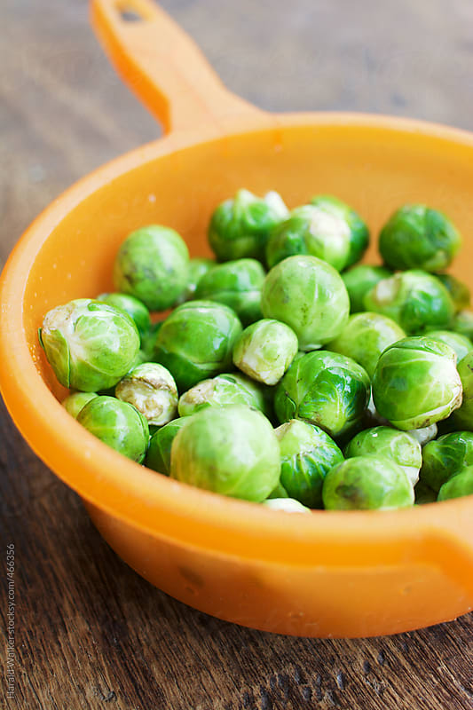 Fresh Brussels sprouts by Harald Walker for Stocksy United