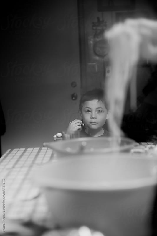 Boy Waiting For Spaghetti Dinner by Ronnie Comeau for Stocksy United