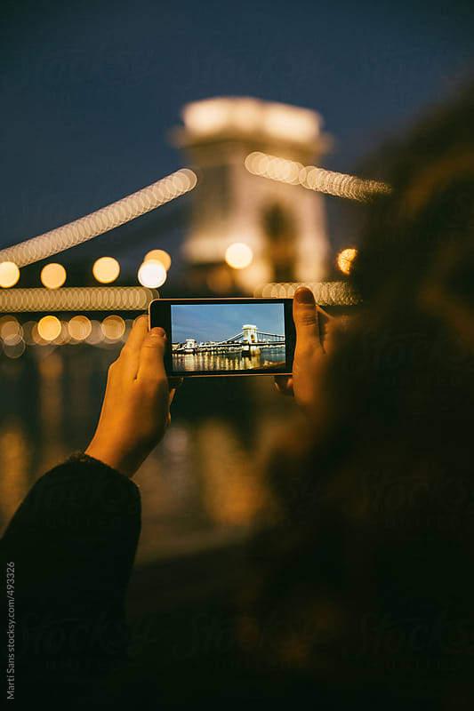 Taking a picture of chain bridge in Budapest by Martí Sans for Stocksy United