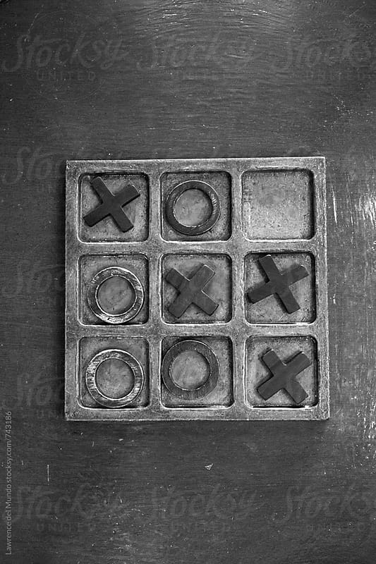 The X wins in a game of tic tac toe by Lawrence del Mundo for Stocksy United