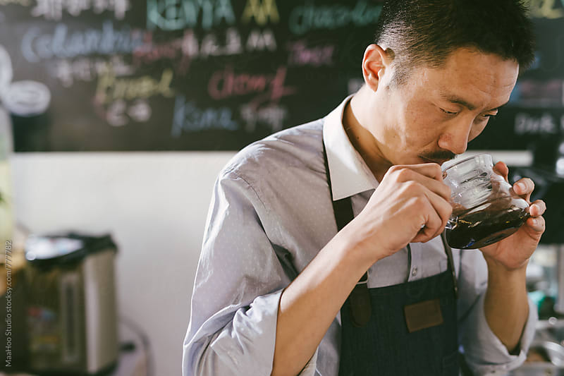 Young man preparing coffee by MaaHoo Studio for Stocksy United
