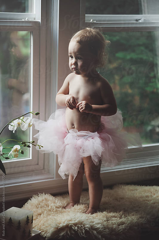 Cute toddler girl in tutu by Rob and Julia Campbell for Stocksy United