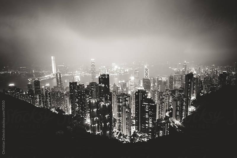 Metropolis skyline at night by Chris Zielecki for Stocksy United