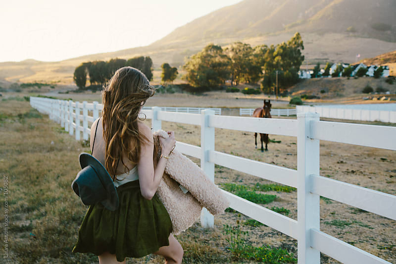 Young Woman With A Horse by Laura Austin for Stocksy United