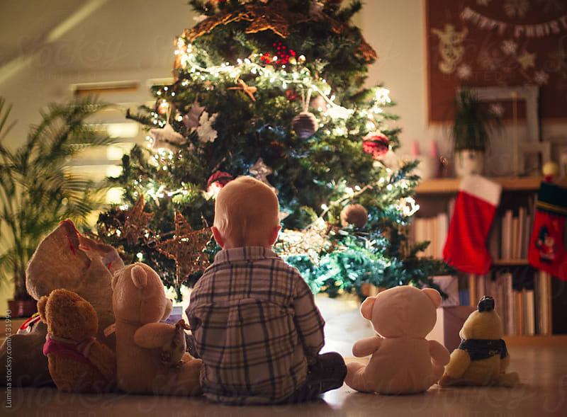 Boy Playing by the Christmas Tree by Lumina for Stocksy United