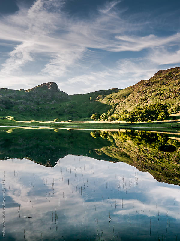 Sky being Reflected in the Waters of Blea Tarn in the Lake District by Andreas Wonisch for Stocksy United