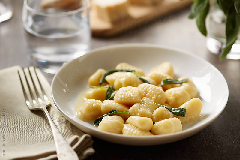 Delicious gnocchi with butter and sage by Martí Sans for Stocksy United