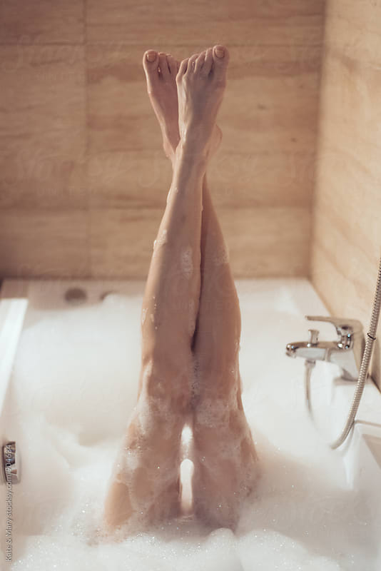 Woman legs in bath by Katarina Simovic for Stocksy United