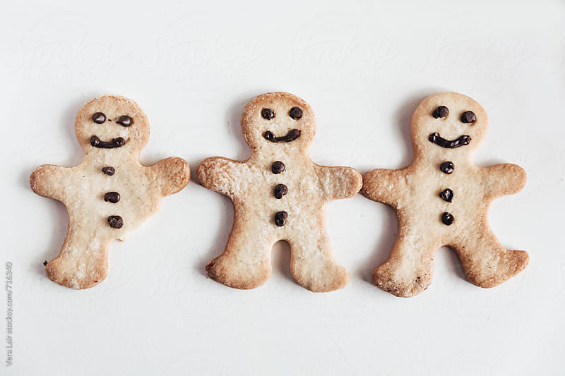 Three gingerbread men cookies, one with a handicap by Vera Lair for Stocksy United