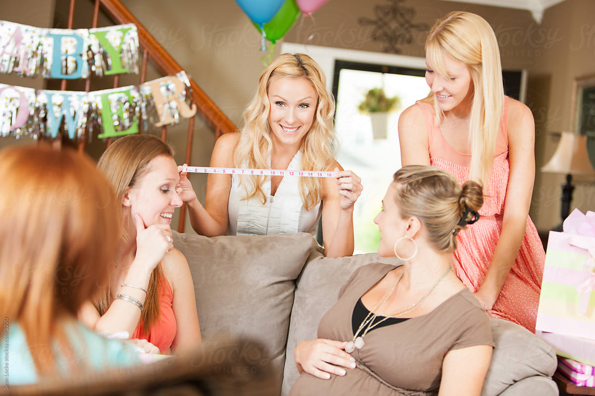 Baby Shower Friends Playing Game To Guess Size Of Mom S Belly By Sean Locke Party Shower Stocksy United