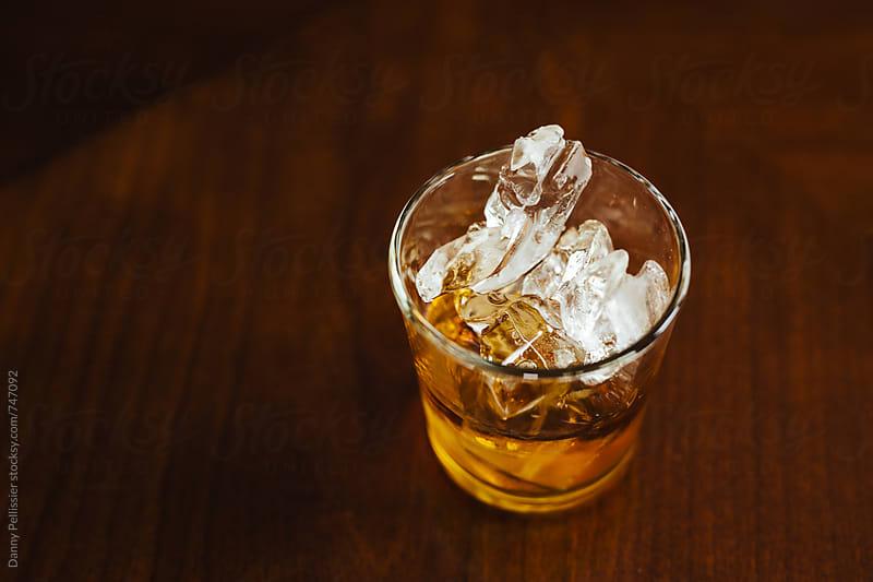 Whiskey on the rocks by Danny Pellissier for Stocksy United