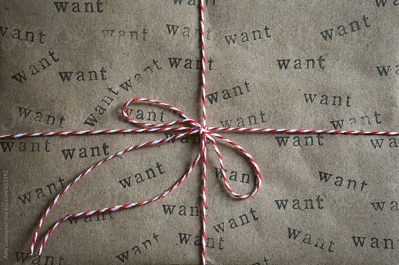 Close up of a wrapped gift with homemade wrapping paper  by Amy Covington for Stocksy United