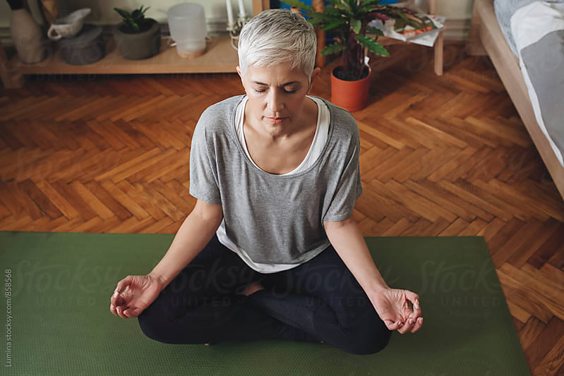 Woman Meditating in the Lotus Pose. by Lumina for Stocksy United