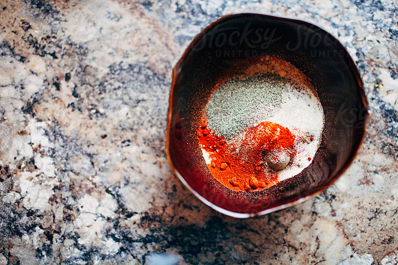 a bunch of tasty spices in a bowl by Sarah Lalone for Stocksy United