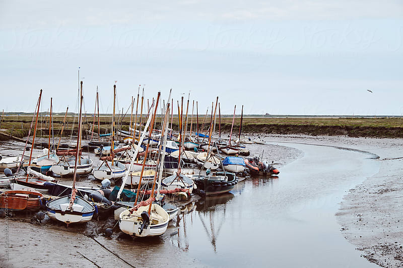 Sailing boats at low tide. Morston Quay, Norfolk, UK. by Liam Grant for Stocksy United