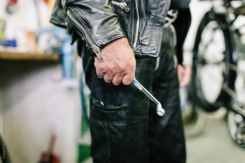 Close-up of Senior adult with wrench by VegterFoto for Stocksy United
