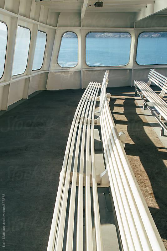 Empty White Benches On Upper Deck Of Passenger Ferry Boat by Luke Mattson for Stocksy United
