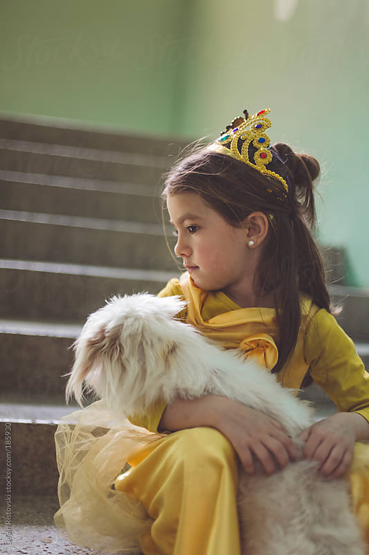 Little princess with her pet by Dejan Ristovski for Stocksy United