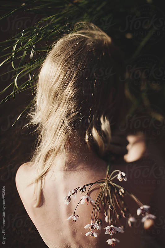 The back of the girl and beautiful blond hair by Sergey Filimonov for Stocksy United