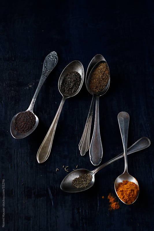 Spices in spoons by Noemi Hauser for Stocksy United