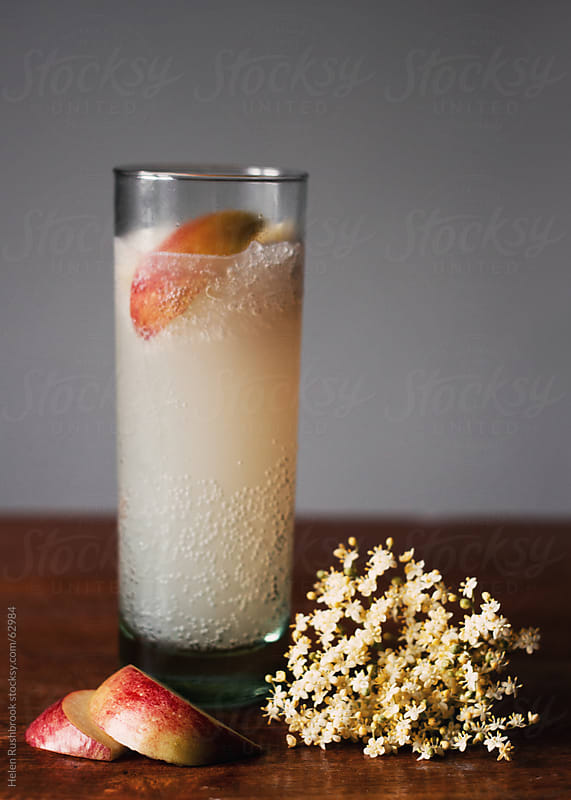 A Summer cocktail by Helen Rushbrook for Stocksy United